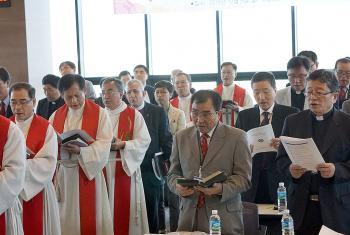 LWF President Bishop Younan, centre, attends a church service in South Korea. He condemned the division between the two Koreas, saying walls incite hatred.