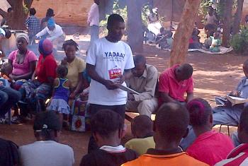 Kheke Chana warns residents of a Zambian village of the dangers of drug and alcohol abuse. Photo: ELCZ