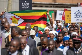 "A demonstration by the Zimbabwe Council of Churches, under the theme ""The church says no to violence!"" the image was widely shared on social media to advocate for peace. Photo: ZCC"