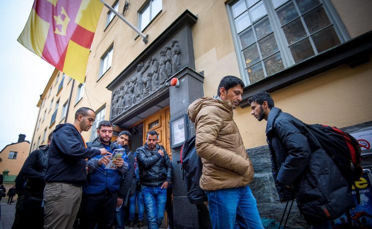 Newly arrived refugees outside the parish house of Katarina Parish, Stockholm, Sweden. Photo: Magnus Aronson /Ikon