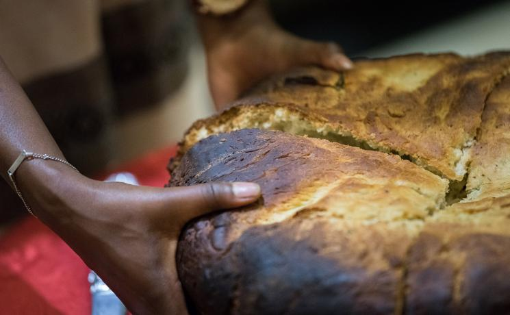 Traditionally baked Ethiopian bread being shared out with participants at a global consultation on Lutheran identities in Addis Abeba in October 2019. Photo: LWF/Albin Hillert