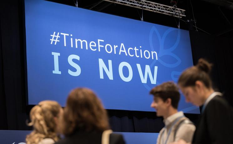 """Young people attending COP25 in Madrid, Spain, in 2019. The slogan """"#TimeForAction is now"""" has not lost its urgency. Photo: LWF/Albin Hillert"""