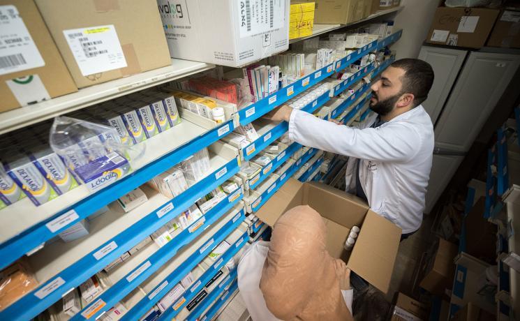 Dr Farmacist Nicolas Saliba restocks medicine at Augusta Victoria Hospital, Jerusalem. Photo: LWF/Albin Hillert