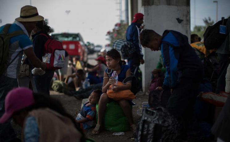 Migrants from Central America at the Mexican border in Nov 2018. Many of them have been walking for 22 hours or more. Photo: LWF/Sean Hawkey