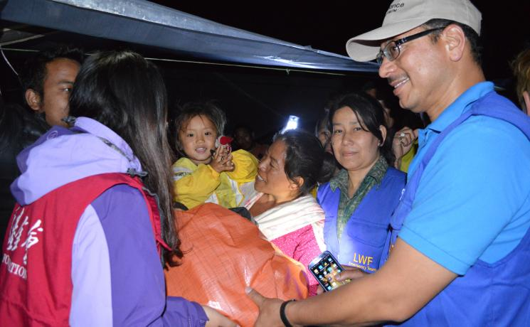 LWF Nepal distributing much-needed supplies to earthquake victims.  Photo: Laxman Niroula