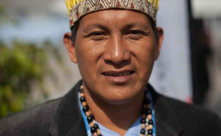 Activist displaying traditional headdress at COP20. Photo: LWF/Sean Hawkey