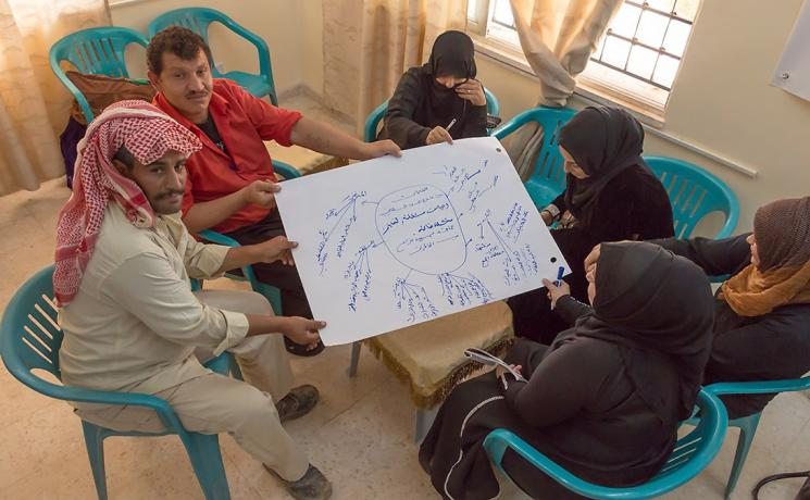 Syrian refugees and Jordanian host community members participate in workshop on peace-building and hygiene, the first joint pilot project by Islamic Relief Jordan and the Lutheran World Federation Jordan. Photo: Islamic Relief Jordan