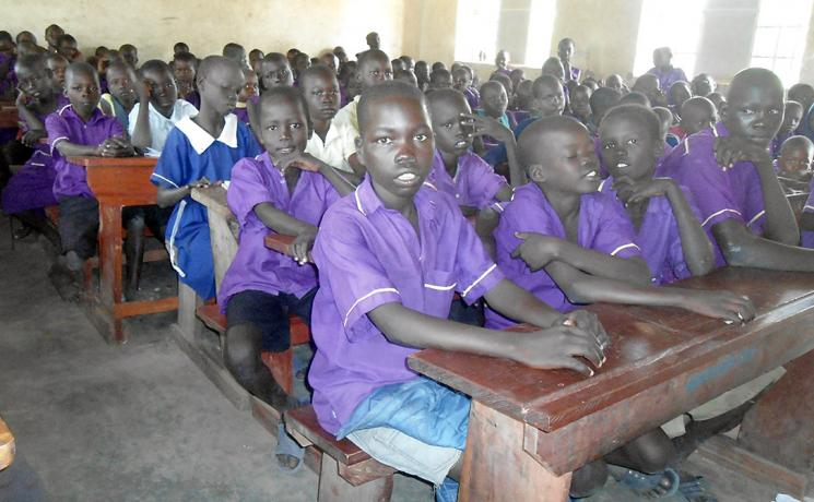 Emmanuel sits in class, supported by the LWF and safe from the violence he fled in South Sudan. Photo: LWF Uganda