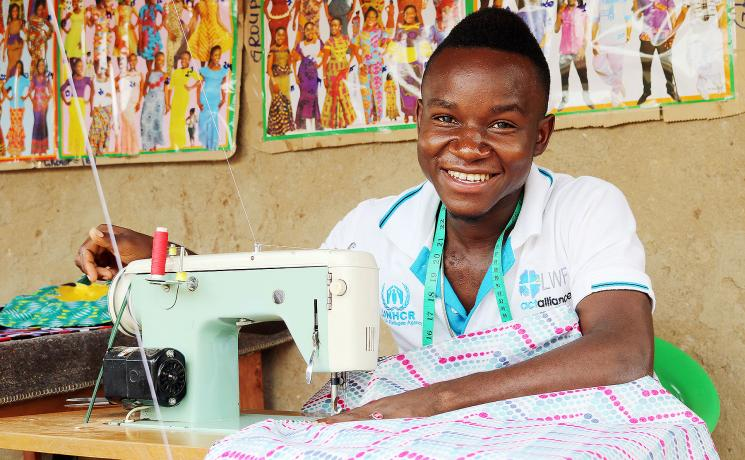 In Uganda, LWF's humanitarian work includes support to people who have fled conflict in neighboring South Sudan and DRC. At the Rwamwanja refugee settlement, Congolese Zubert Masuku is now a highly skilled fashion designer, who also trains fellow youth for free. Photo: LWF/ S. Nalubega