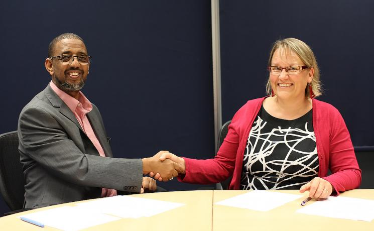 Naser Haghamed, Chief Executive Officer, Islamic Relief Worldwide and Maria Immonen, World Service Director, The Lutheran World Federation shake hands after renewing the Memorandum of Understanding. Photo: Islamic Relief Worldwide