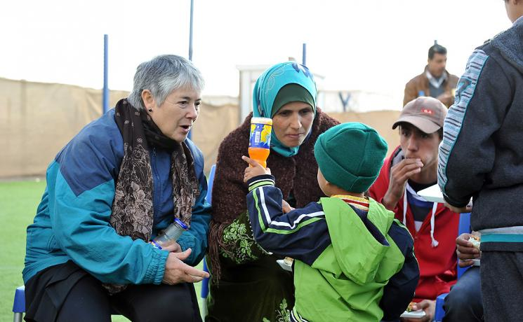 Rev. Dr Gloria Rojas Vargas, LWF Vice President and former president of the Evangelical Lutheran Church in Chile, shares a joke with Ahmad at the LWF Peace Oasis in Za'atari refugee camp. Photo: LWF/ C. Kästner