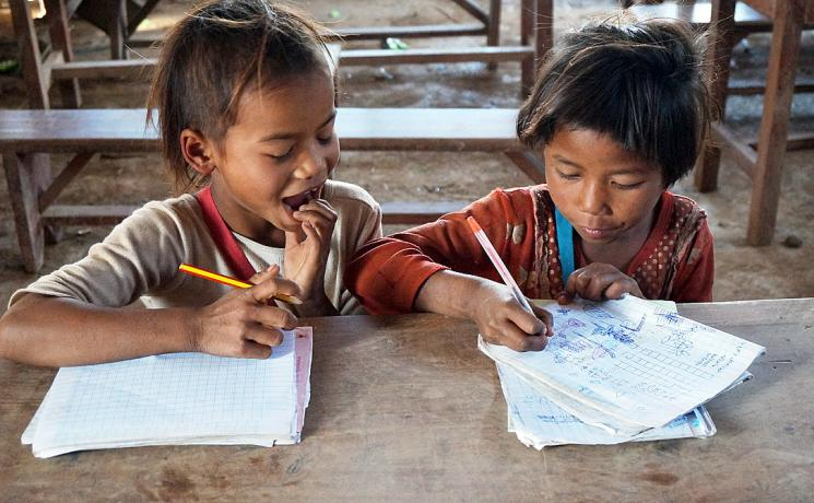 Caption: Vone and Viengkeo are eager students at the local school. Photo: LWF Laos