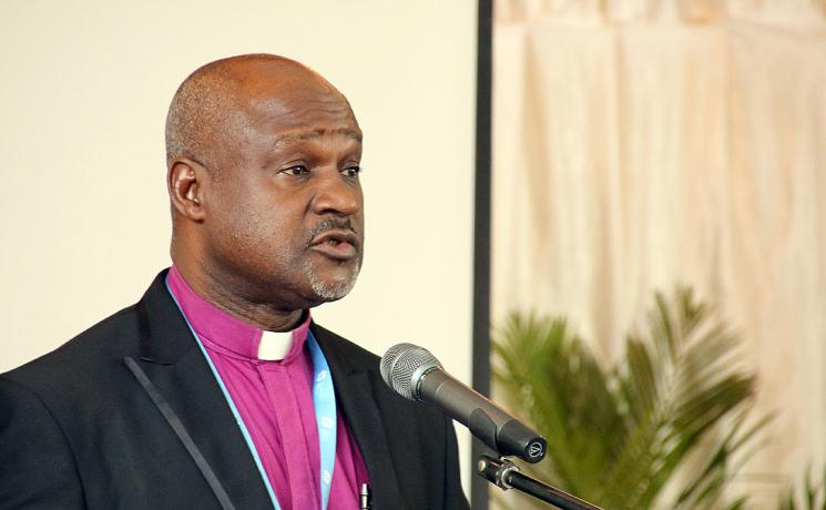 Lutheran Church of Christ in Nigeria Bishop Dr Panti Filibus Musa makes his presentation at the May 2015 consultation and 60th anniversary of African Lutheran church leaders in Moshi, Tanzania. Photo: LWF/Tsion Alemayehu