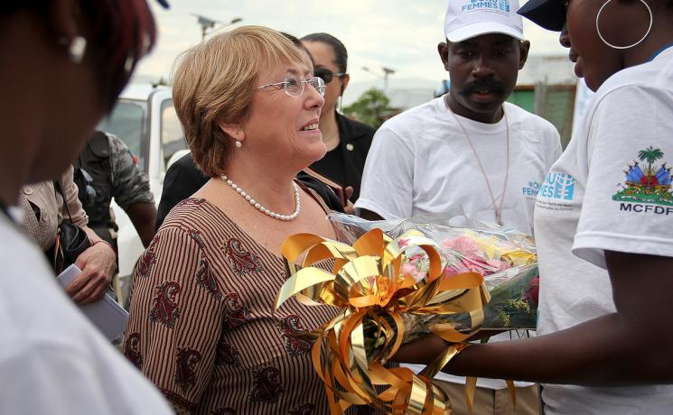 Michelle Bachelet receives flowers during a visit to Haiti in 2012 during her tenure as UN Women executive director. Photo: UN Women (CC-BY-NC-SA)