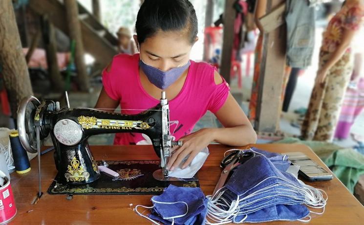 A woman entrepreneur sews cloth face masks in Kyauk Tan Gyi village, Sittwe Township, Rakhine State, Myanmar. Photo: LWF/Nu Nu Aye