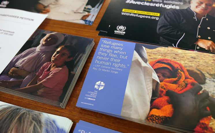 Refugees lose many things, but never their human rights: LWF and UNHCR visibility material at the panel discussion. Photo: LWF/ A. Danielsson