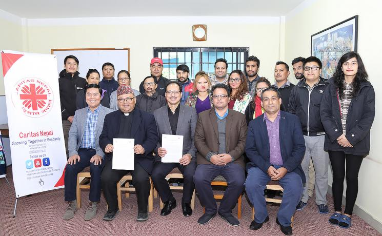 LWF representatives and Caritas Nepal team after signing the MoU in the Caritas Nepal office. Photo: LWF