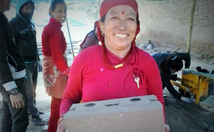 Kabita Shrestha's friend Kanchhi Shrestha carrying an unfired brick. Photo: LWF/Lucia de Vries