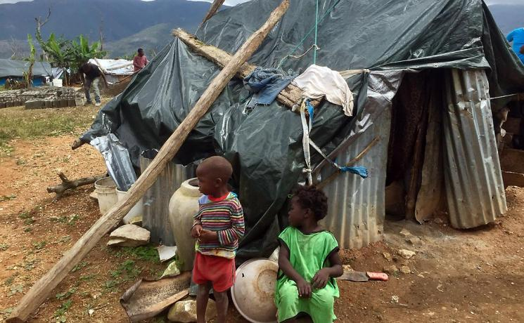 Like the family of Polonne Jean-Louis, many people still live in makeshift shelters after hurricane Matthew destroyed their homes. Photo: LWF/M. French