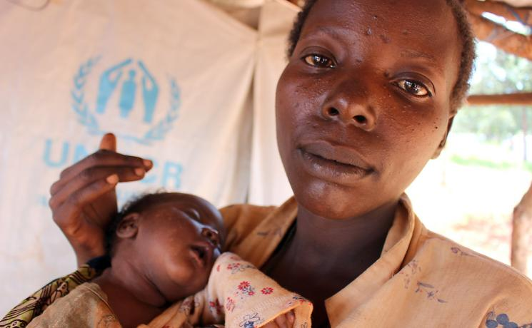 Hatungaimana Justina gave brith to baby Furaha Eliza just days after fleeing her native Burundi. She and her family made it to the safey of the Mtendeli camp where LWF partner, Tanganyika Christian Refugee Service drills boreholes that supply water to the camp. Photo: LWF/S.Cox