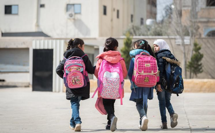 A group of girls head to a school in Jordan's Sahab district that is supported by LWF for both Jordanian and Syrian children. Photo: LWF/Albin Hillert