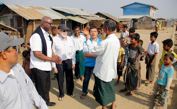 LWF president Archbishop Panti Filibus Musa visits displaced Rohingya at the Ohn Taw Gyi South IDP camp, Rakhine state, Myanmar, in 2018. Photo: LWF/ Phyo Aung Hein