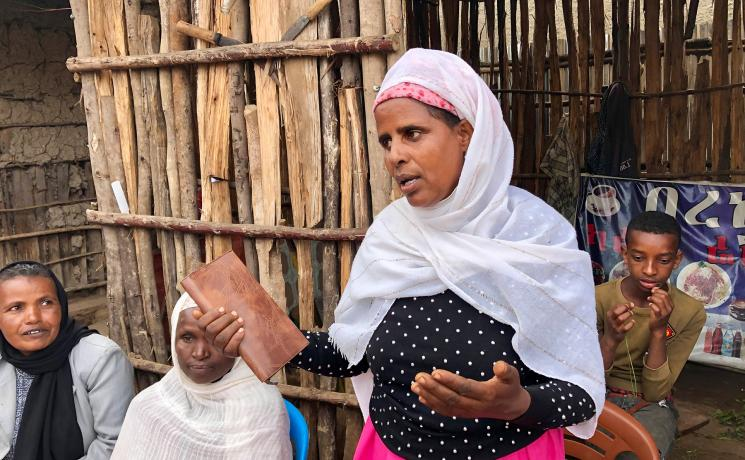 A member of a Symbols of Hope Ethiopia women's self-help group in the southern region of Hosaena, sharing her experiences. Photo: LWF/M. Dölker