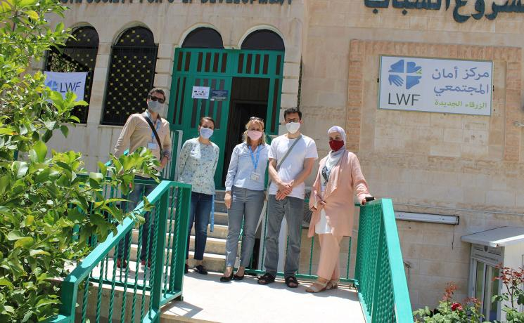 Erik Siegl from Czech Diaconia with LWF's Caroline Tveoy and staff from the World Service team in Jordan outside the Aman community center in Zarqa. All photos: LWF/Jordan