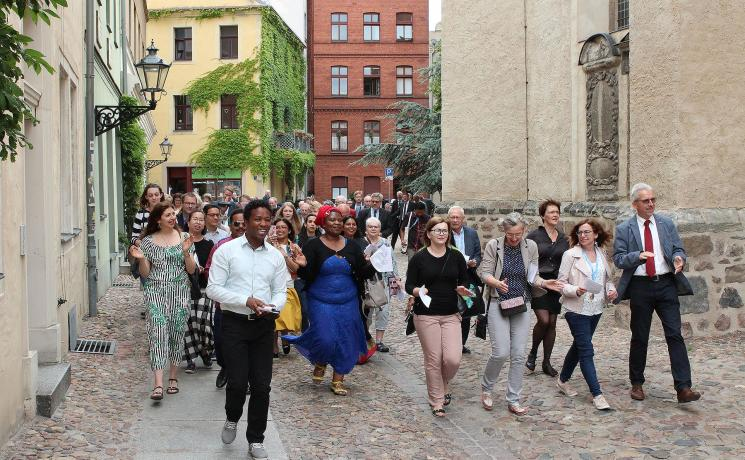 International guests move from the Town Church to the premises of the LWF Center Wittenberg and the ELCA Wittenberg Center during the joint anniversary celebrations. Photo: GNC/LWF Florian Hübner
