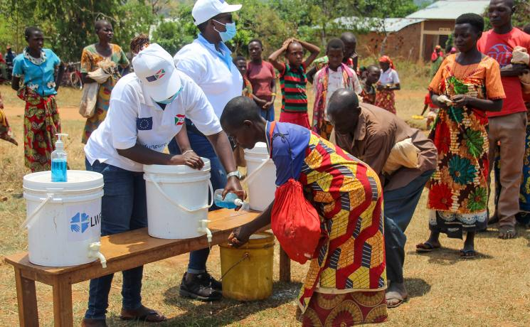 Hand washing before a distribution in Burundi. Water is essential to proper hygiene and to prevent the spread of COVID-19. Photo: LWF Burundi