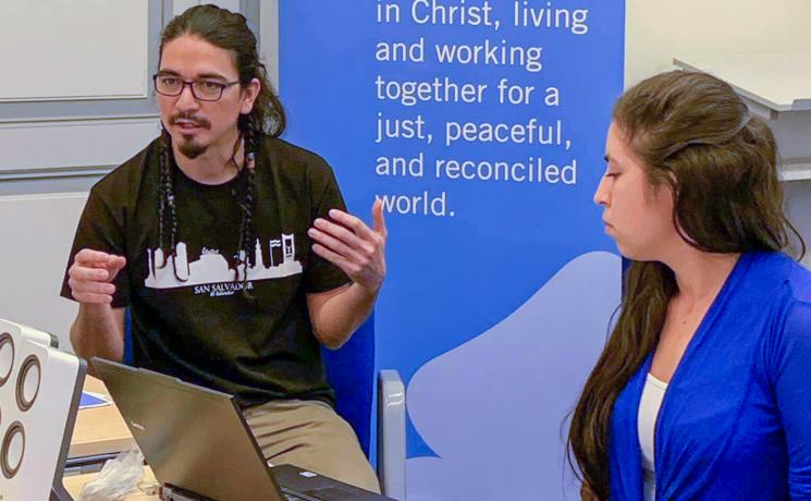 At the 2019 Peace Messengers international training workshop in Tallinn, Estonia, Juan Carlos Orantes Rodríguez (left) and Oneyda Elizabeth Fuentes Rivera, sharing about the church's role in peacebuilding in El Salvador. Photo: LWF/S. Kit