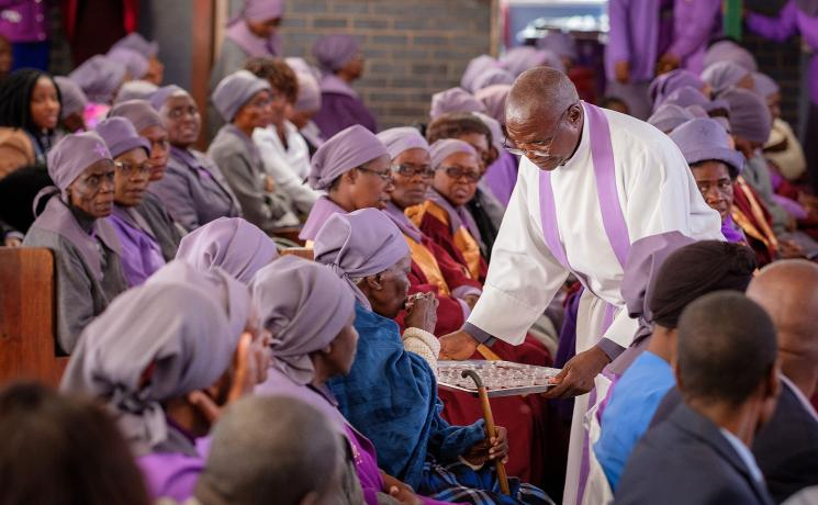 A member of the Bulawayo congregation receives communion during the Sunday service. Photo: LWF/A. Danielsson