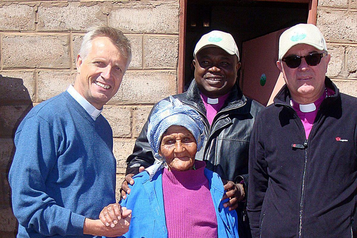 Rev. Martin Junge, Presiding Bishop Dr Alex G. Malasusa and Bishop Dr Frank O. July visit a parishioner in southern Namibia. Photo: LWF/Klaus Rieth