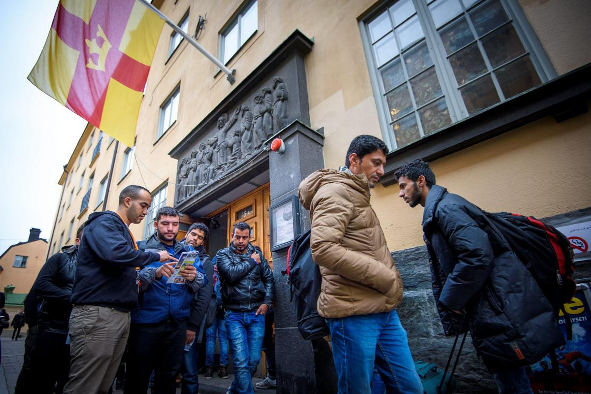 Newly arrived refugees outside the parish house of Katarina Parish, Stockholm, Sweden. Photo: Magnus Aronson /Ikon