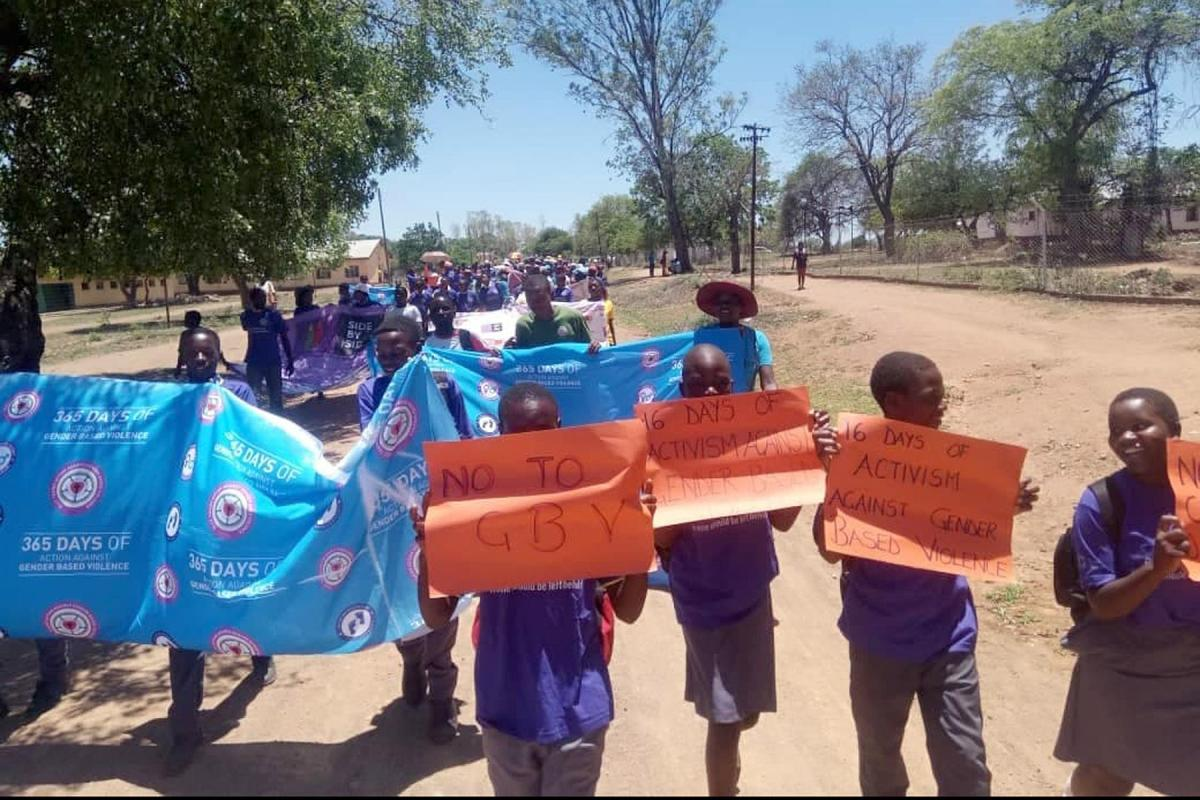 School children in Zimbabwe's Greater Bulawayo district take part in a march marking the 16 Days campaign to end Gender-Based Violence. Photo: EVCZ/Elitha Moyo