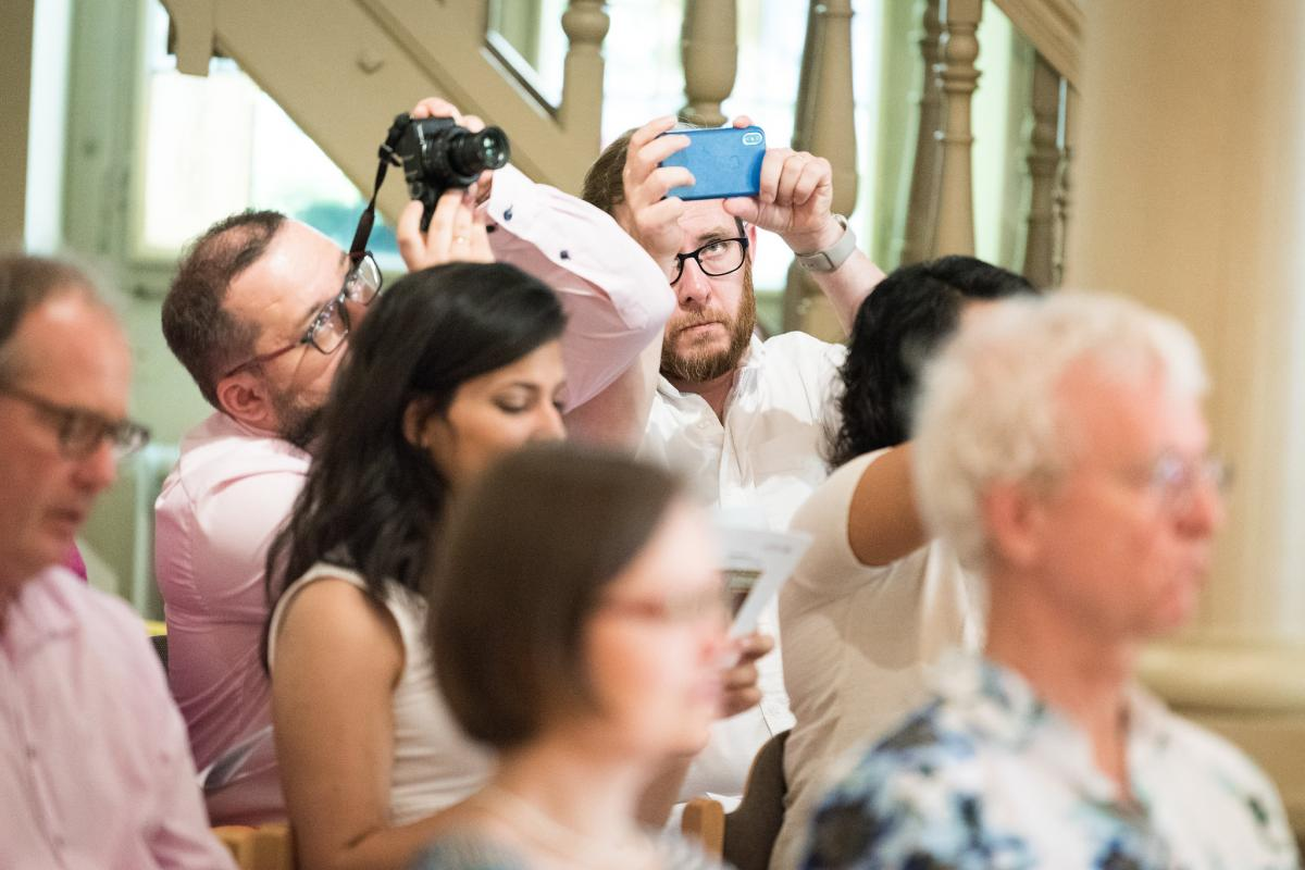 LWF head of communications Árni Svanur Danielsson (right) and Dr Jerzy Janusz Sojka from the Evangelical Church of the Augsburg Confession in Poland take photos during the LWF Council meeting 2018. Photo: LWF/ Albin Hillert