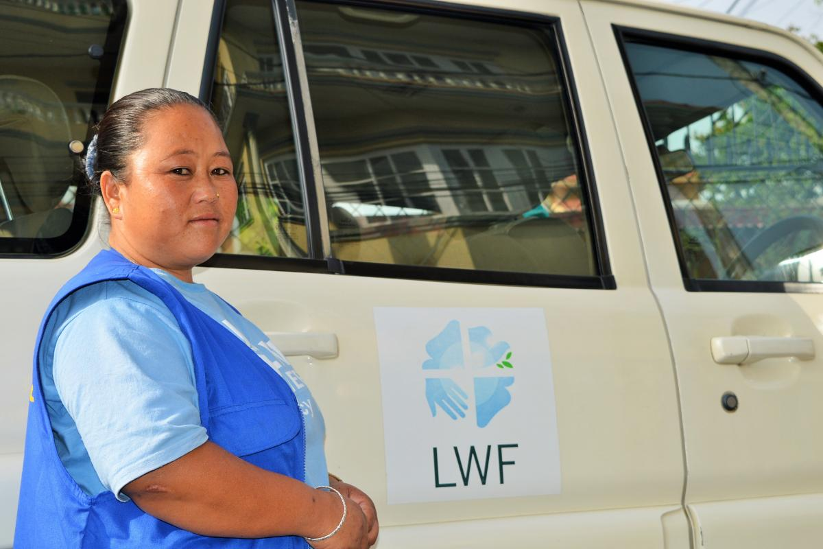 Driver Anita Rana Magar faced angry crowds and landsides during a relief mission. Photo: LWF/ L. de Vries