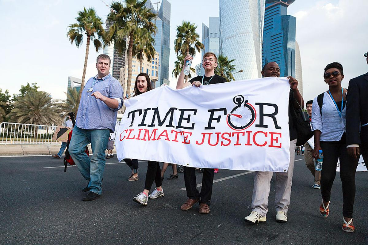 Lutheran youth and ecumenical partners joined hundreds of demonstrators on 1 December for a climate march in Qatar to demand action at the COP 18 summit. © LWF/Sidney Traynham
