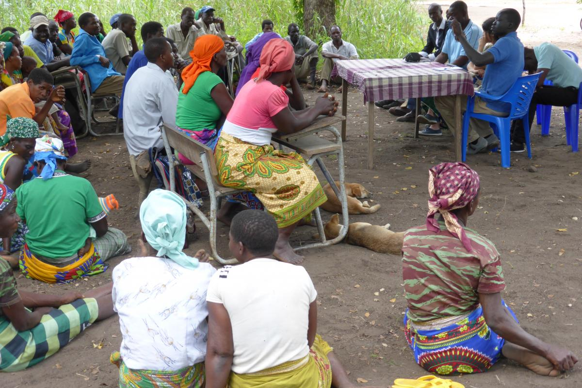 LWF staff collect information about human rights concerns at a village in Mozambique. Photo: S. Oftadeh