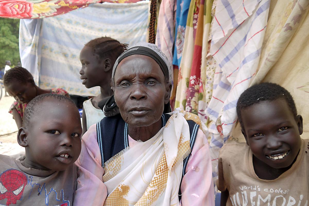 Tabisa Nyabol and her grandchildren in Adjumani, Uganda. Photo: ACT-DCA-LWF/Mai Gad