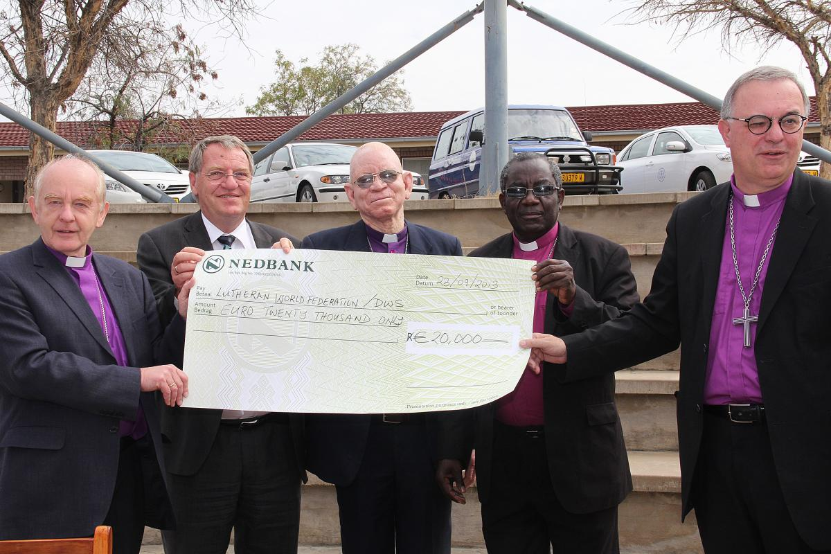LWF Delegation presenting donation to drought relief. © The Namibian
