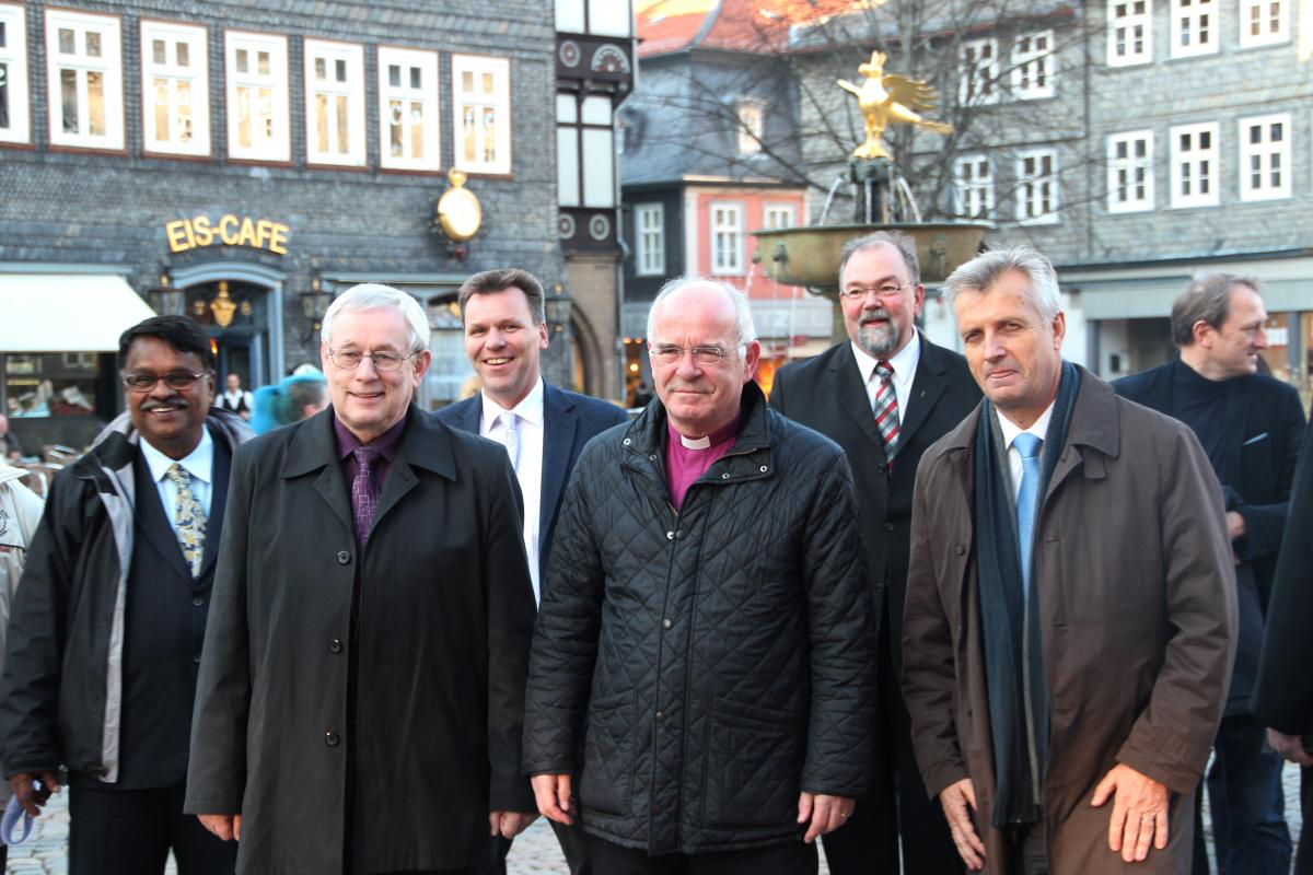 LWF General Secretary Rev. Martin Junge (right) with the Bishop of Brunswick Prof. Dr. Friedrich Weber (center), Jan Waclawek (left), Bishop of the Silesian Evangelical Church of the Augsburg Confession in the Czech Republic, and other guests during the walk through the city of Goslar. Photo: DNK/LWF. Hübner