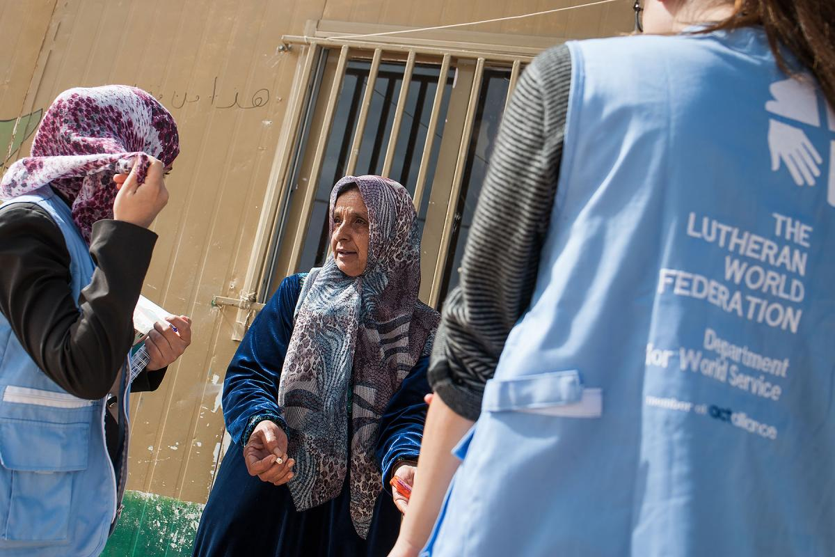 LWF humanitarian workers assist a woman in the Middle East. Photo: Christian Jepsen