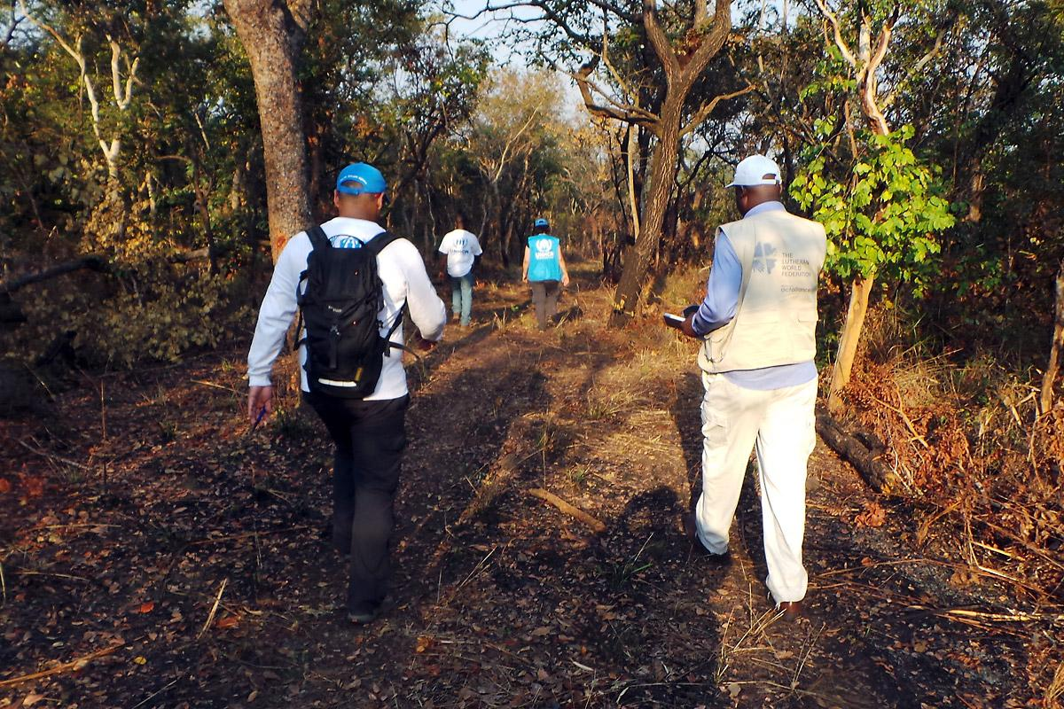 LWF and UNHCR staff survey a site designated for a new refugee camp in Lunda Norte province, northeastern Angola. Photo: LWF