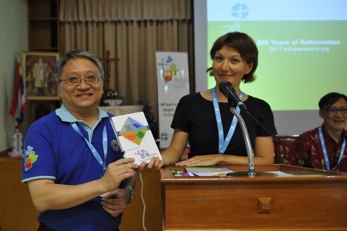 Anne Burghart, Secretary for Ecumenical Relations, with the Chinese translation of the Reformation Booklets.