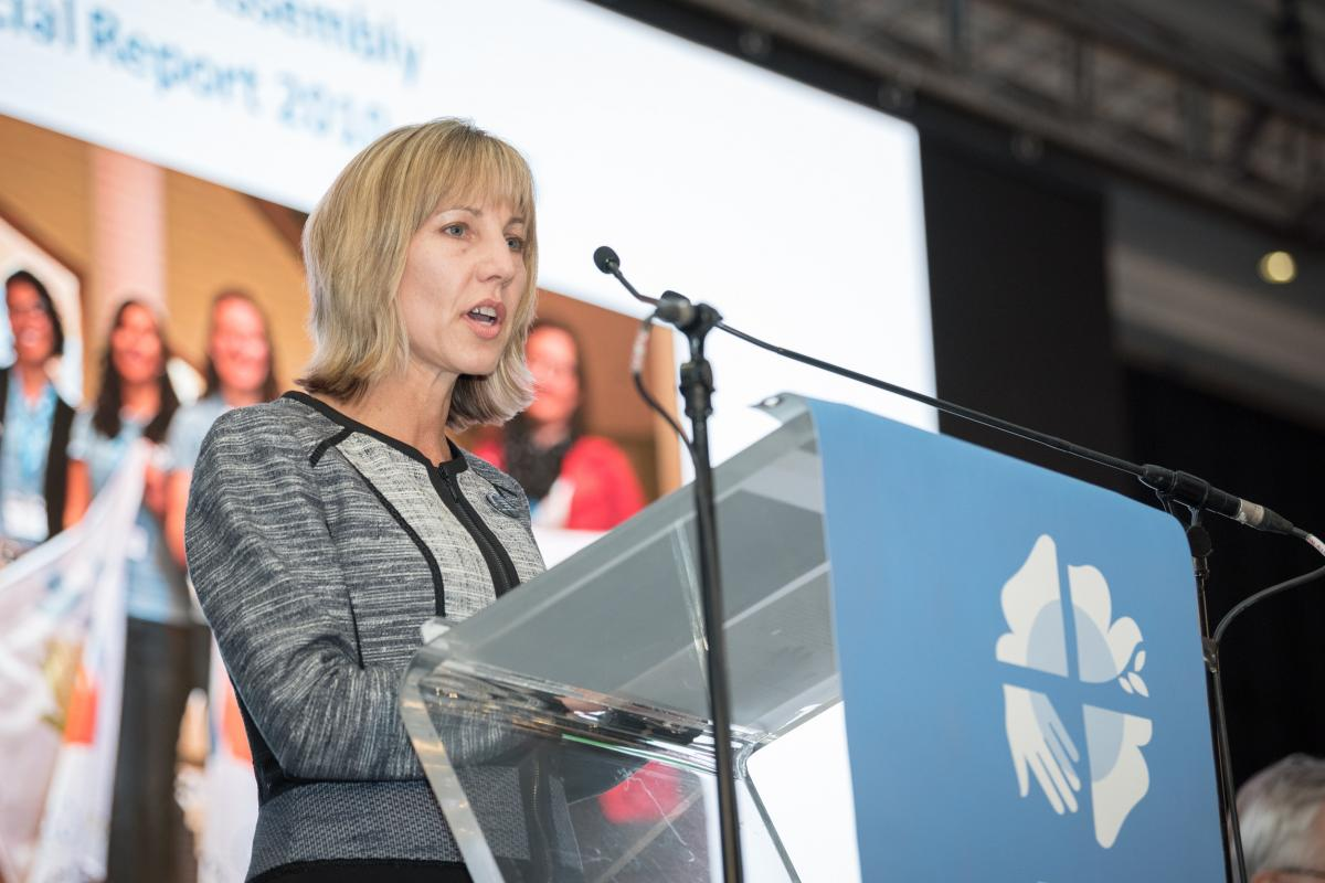 Christina Jackson-Skelton giving the report of the Finance Committee at the Lutheran World Federation's Twelfth Assembly. Photo: LWF/Albin Hillert
