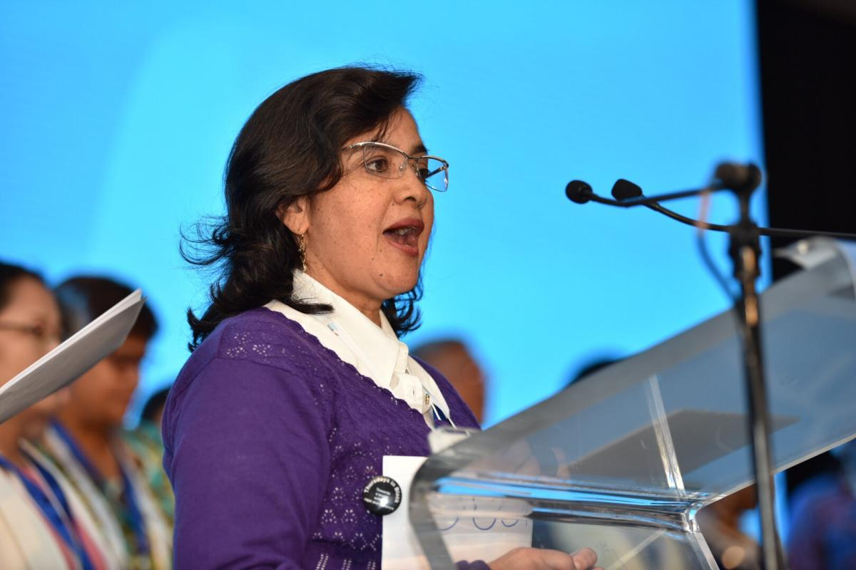 Delegate of the Women's Pre-assembly delivers the message to Twelfth LWF Assembly delegates. Photo: LWF/ Albin Hillert