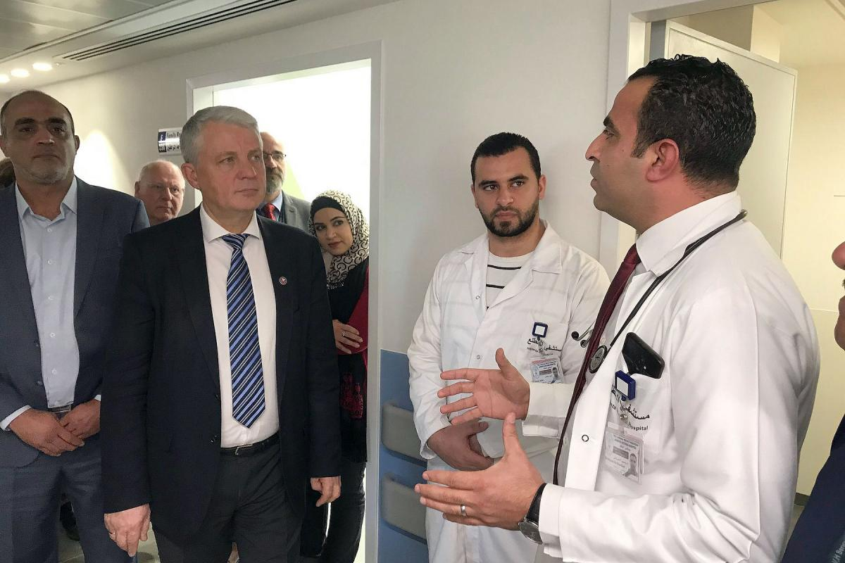 The Secretary General of NCA receiving a detailed briefing from the doctors and nurses at AVH. Photo: NCA