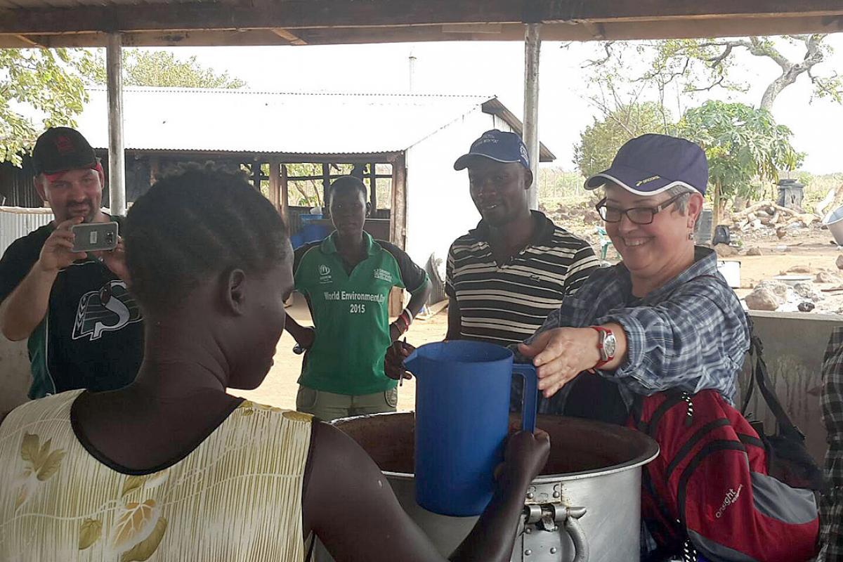 Bishop Susan Johnson handing out relief goods to refugees in Nyumanzi reception center. Photo: LWF Uganda