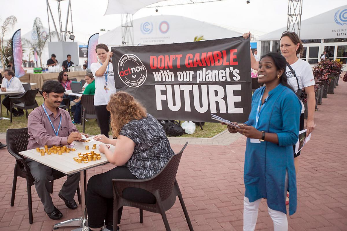 """ACT Alliance climate campaigners staged a protest """"Don't Gamble with our Future"""" as the UN climate talks drew to a close. Photo: LWF/Sean Hawkey"""